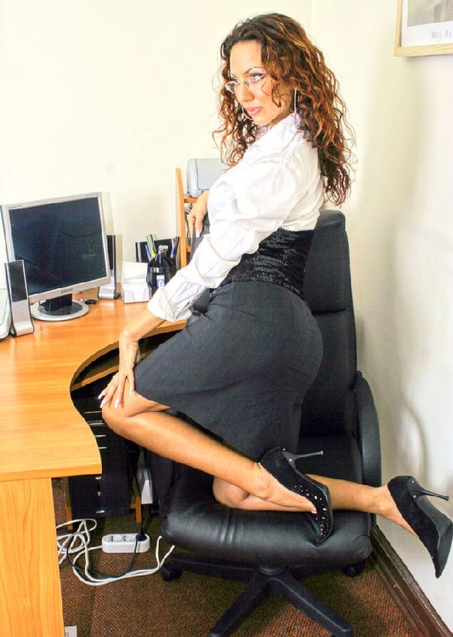 Slutty, naughty secretary in short skirt