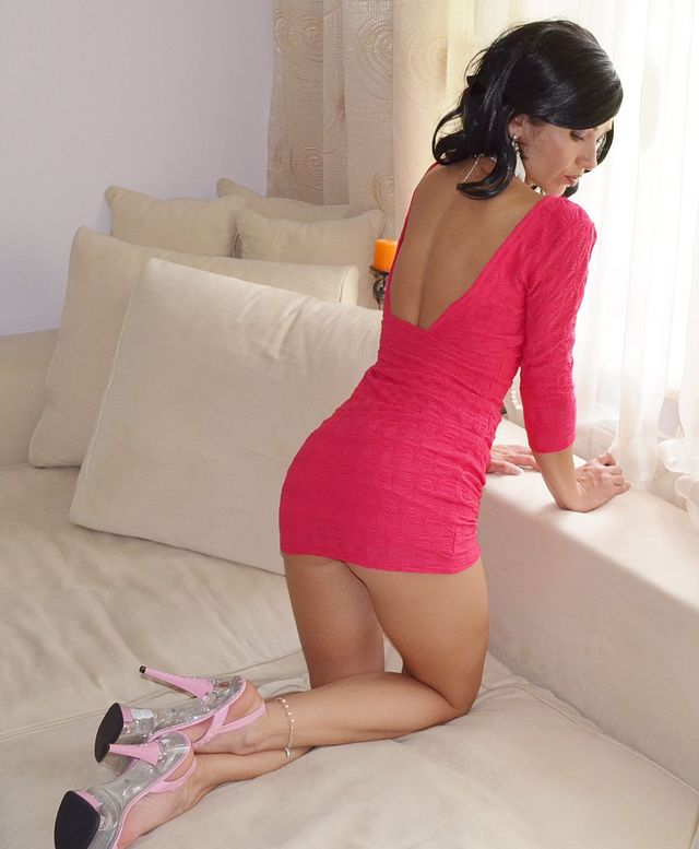 Hot seductive cam girl in short pink dress