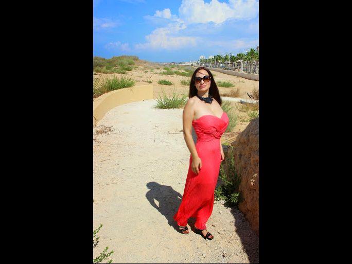Hot, busty MILF Emanuelle in red dress