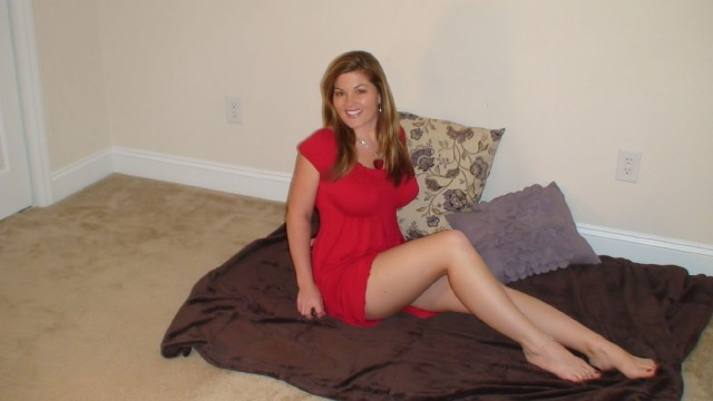 Hot, busty cam girl Alexis in short red dress