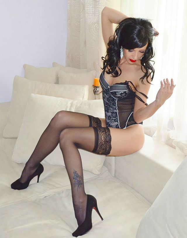 Young, seductive girl Anna in black stockings