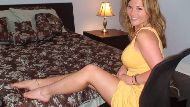 Sweet, busty cam girl Alexis in short yellow dress
