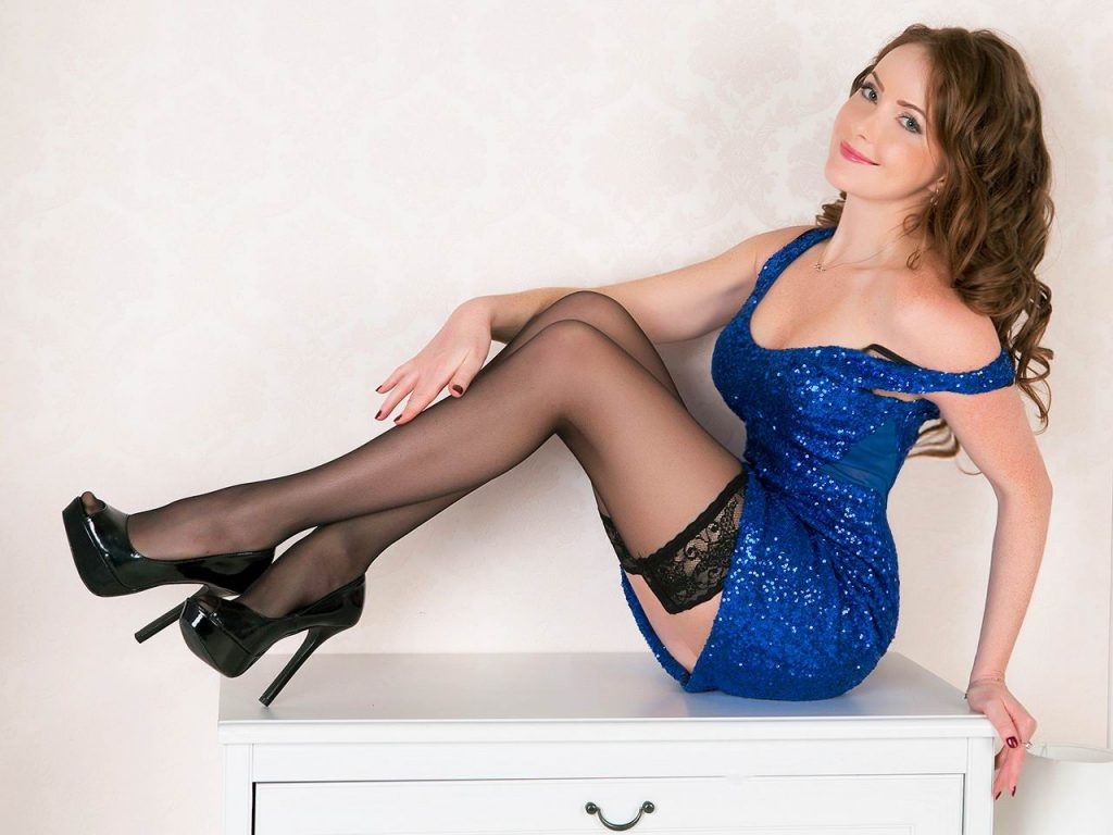 Beautiful cam girl Audrey in short dress and black stockings