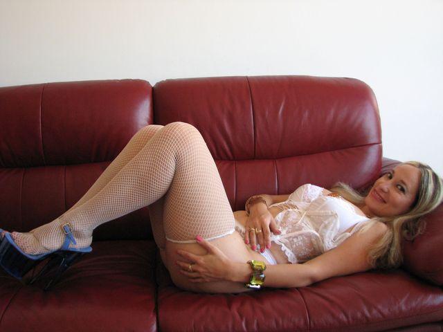 Hot, busty MILF Emanuelle in white lingerie and fishnet stockings