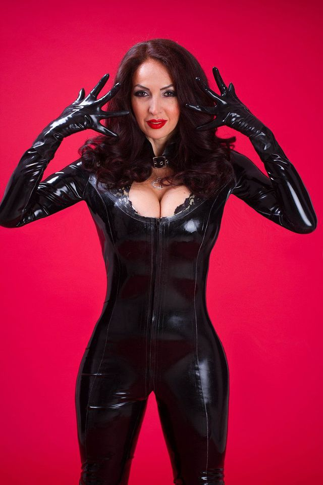 Hot, busty MILF Eden in latex suit