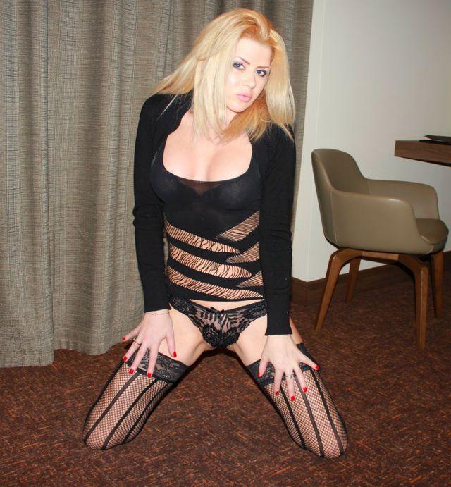 Hot, busty MILF Rachel in black lingerie and stockings