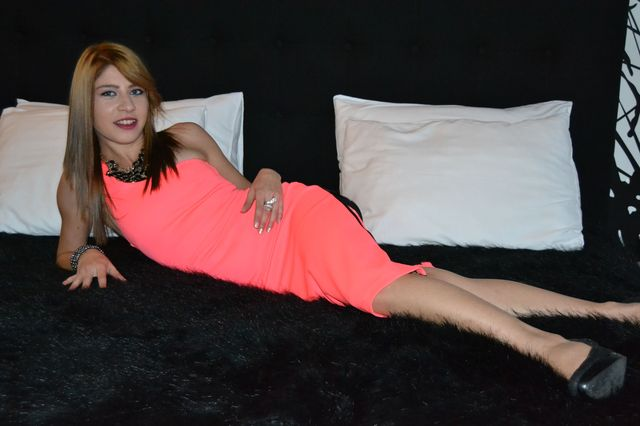 College girl Alessia in new orange dress - sexchat, striptease on cam