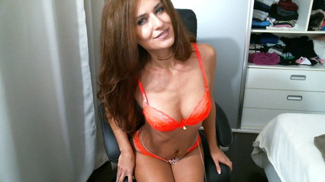 Cam girl Danielle in orange lingerie