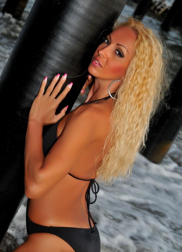 Hot MILF Eden in black bikini