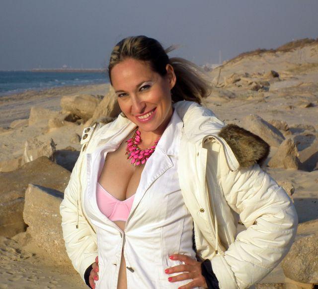 Hot busty MILF Emanuelle