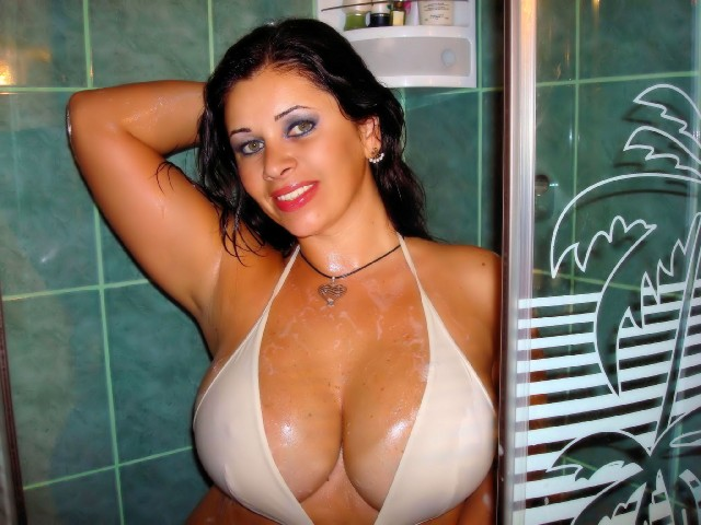 Very big boobs - hot girl Julia in a bathroom