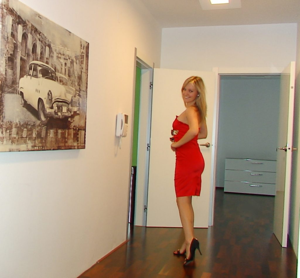 Cam girl Jessy in red dress