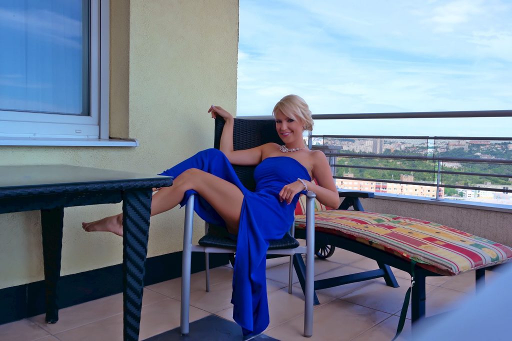 Hot, seductive blonde cam girl Jessy in blue dress