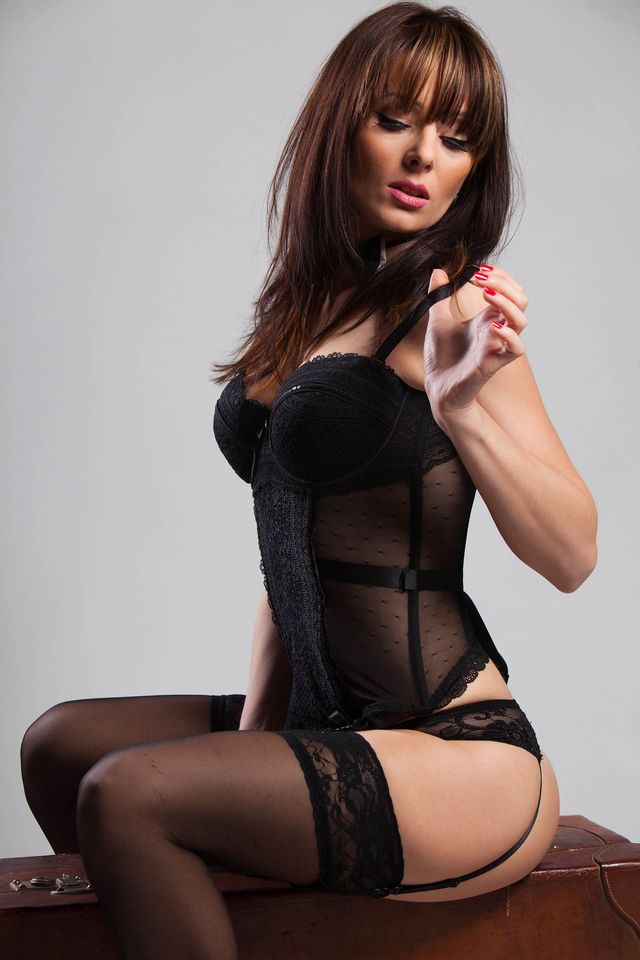 Hot cam girl Simone in black lingerie and stockings